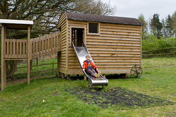 Adventure playground shepherds hut slide