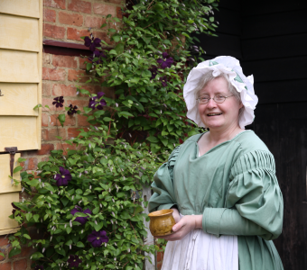 An 18th century re-enactor outside Leagrave Cottages