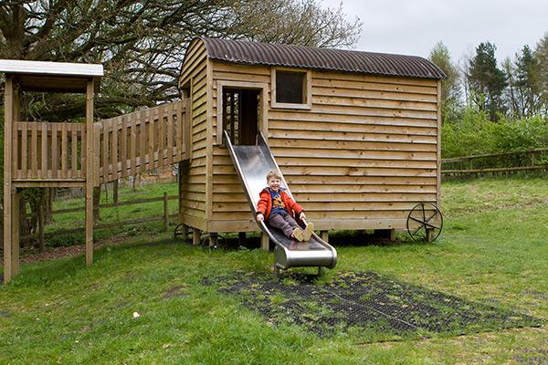 Adventure playground shepherds hut slide
