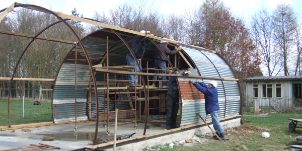 Nissen Hut under construction by volunteers
