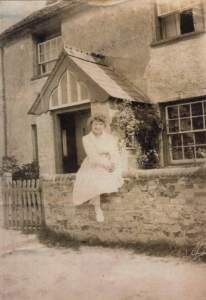 Girl outside Haddenham Croft Cottage