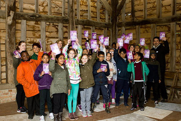 School children holding up copies of Wolf Brother