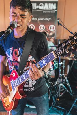 Boy playing guitar at Bucks Music Trust Summer Festival