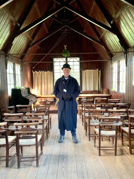 Costumed volunteer steward in Henton Chapel at Chiltern Open Air Museum